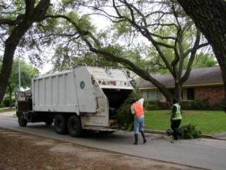 Public Works Employees Load Solid Waste into a Garbage Truck