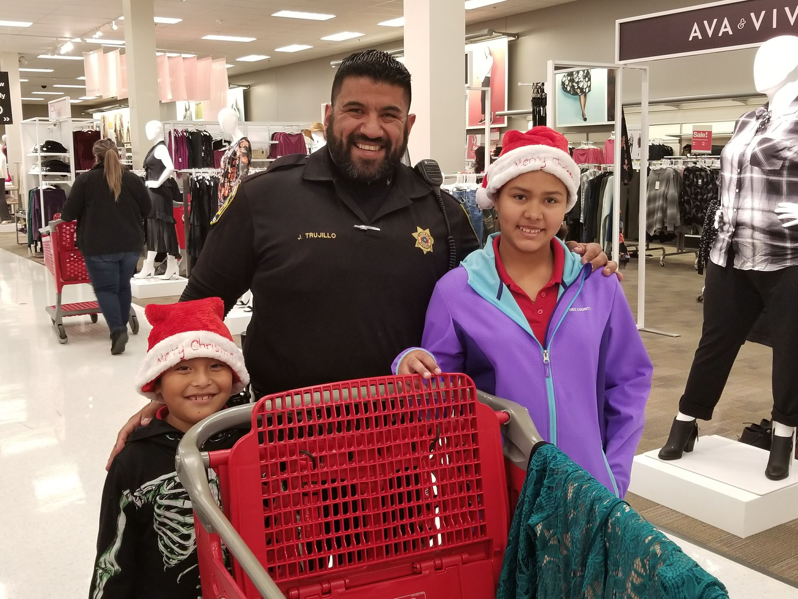Two children and Officer Trujillo shopping at Target