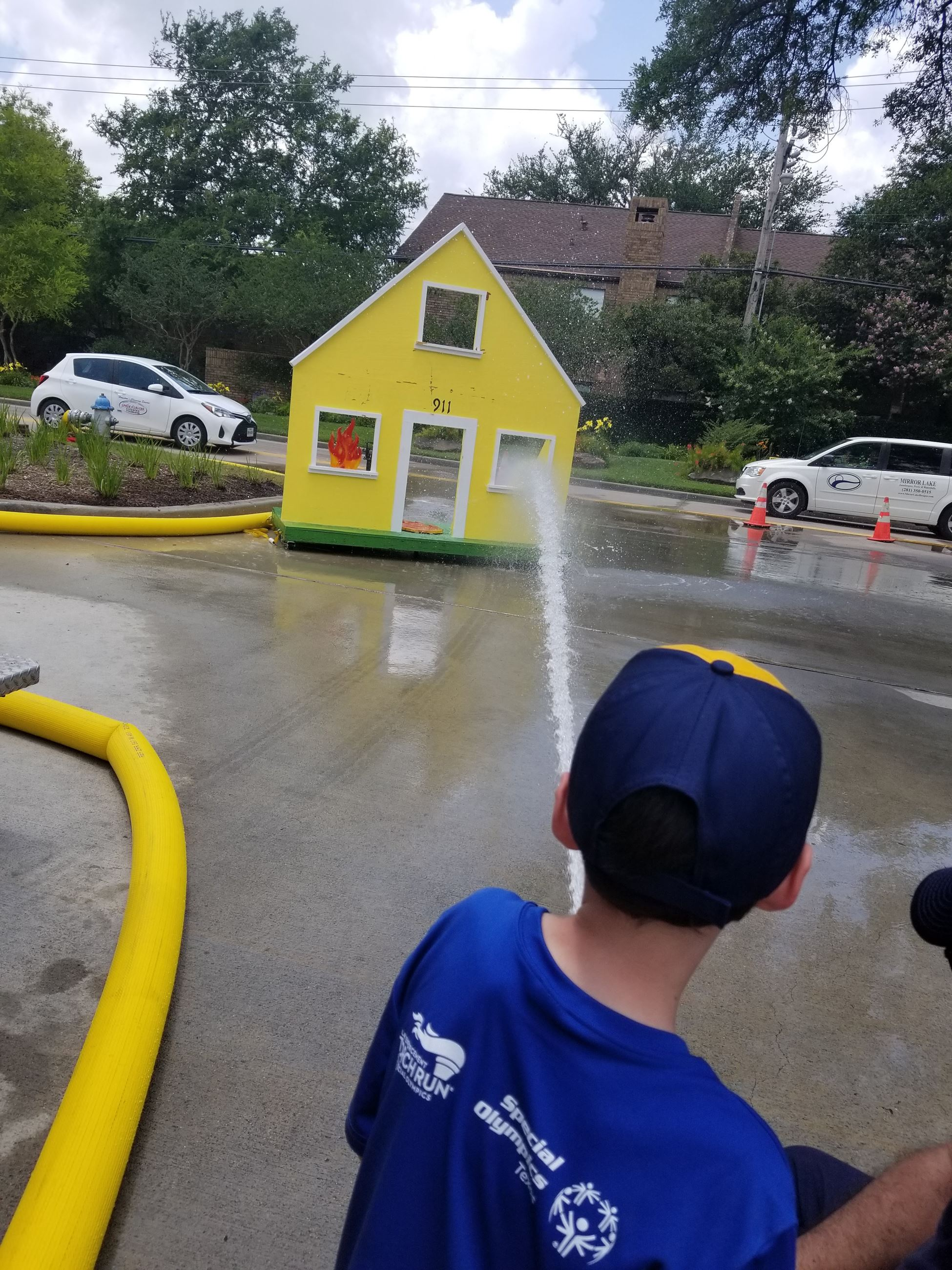 Child Shoots Mock Home with Fireman's Water Hose